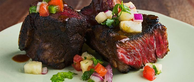 After marinating in a sweet and spicy mixture of pineapple and chipotle, these short ribs are thrown on a hot grill and topped with pineapple pico de gallo for a dish that is short on time and big on flavor.