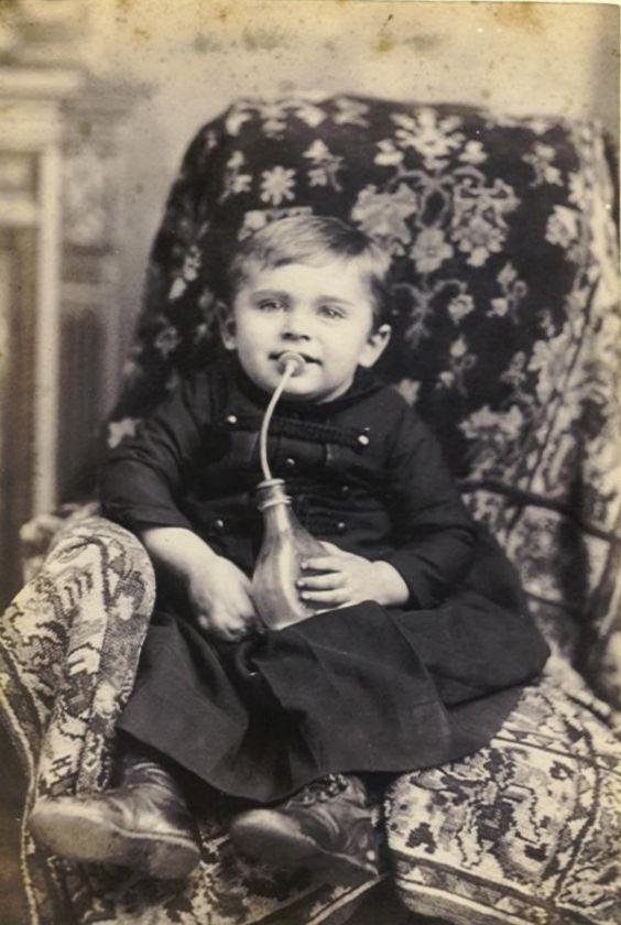 """Many Victorian mothers, while intending to provide the best food and feeding methods for their infants, tragically caused the deaths of their own little ones. Although doctors condemned the bottles and infant mortality rates of the time were shocking – only two out of ten infants lived to their second birthday – parents continued to buy and use them. The bottles eventually earned the nickname, """"Murder Bottles."""""""