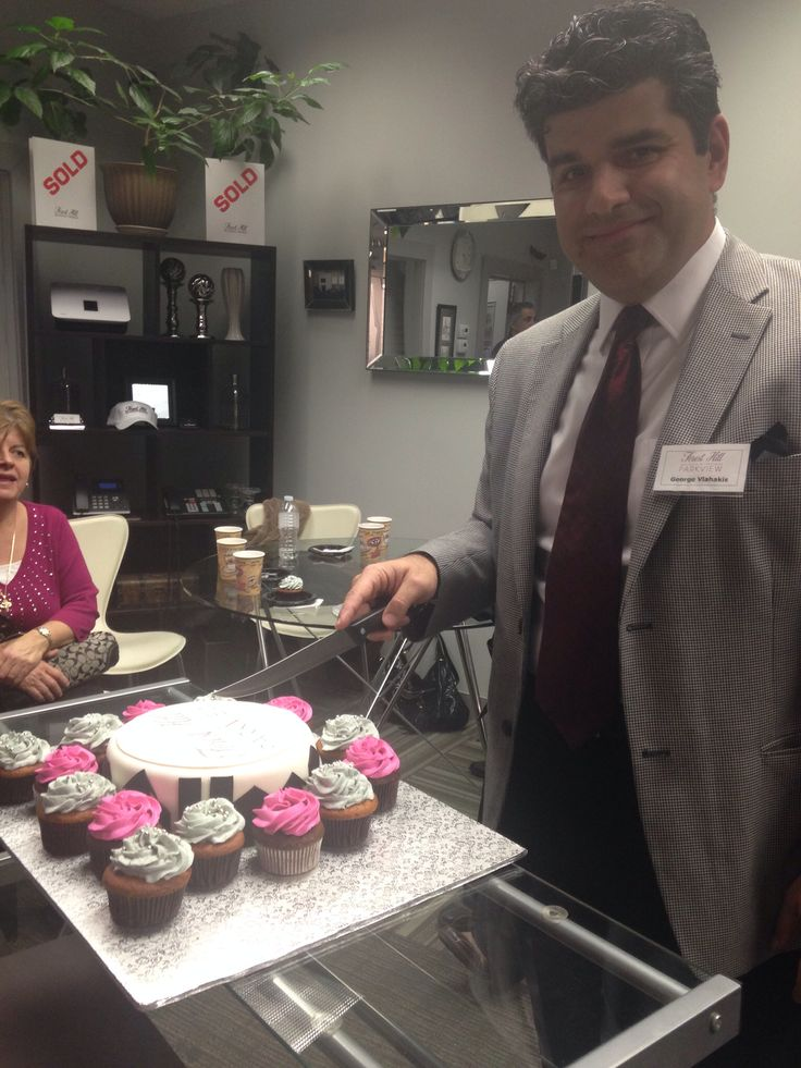 George P. Vlahakis cutting into our cake at an intimate open house for our surrounding community