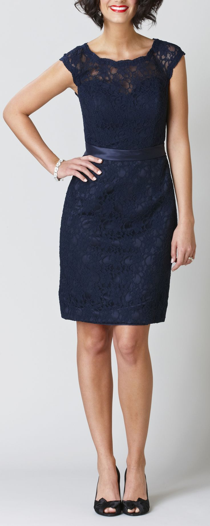 A short, navy lace bridesmaid dress with a stunning keyhole back.