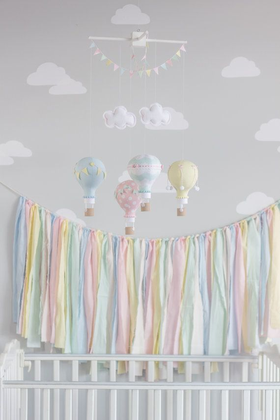 This is a hand tied fabric garland banner to match your nursery, custom mobile or for general holiday use. Measures approximately 45 inches long