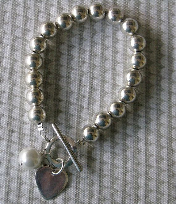 Solid silver ball bracelet with heart and pearl charms