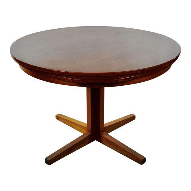 Dyrlund  Dining Table >>Flip Flap<< . It is a marvelous construction, which makes the table a round one even after it has been extended. The leaves come out from under the table top, are unfolded, - and you have a very large round table.