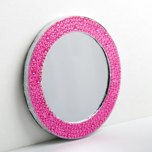 """MAGNETIC LOCKER MIRROR - PINK  Product # ZB21331  $7.98 CAD - Functional locker accessories don't have to be boring! Add some glitz and glam to your space with a glitter mirror has a magnetic back for easy hanging. 6"""" Diam."""
