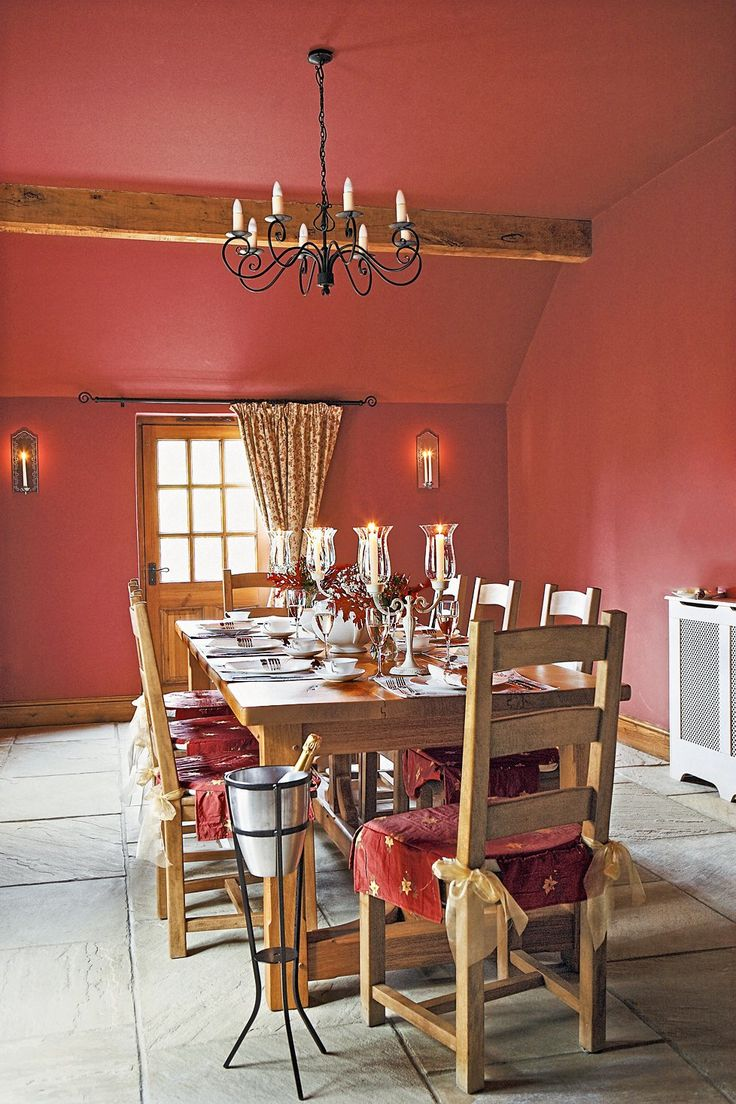 a warm shade like sherwin williamss rave red makes this dining room feel cozy - Bedroom Colors Red