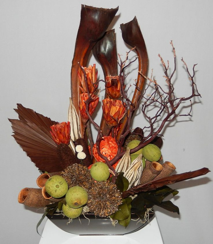 A Fall flavoured Botanical piece done by Dizennio Floral Boutique-Vaughan, these are also becoming more popular in the home too