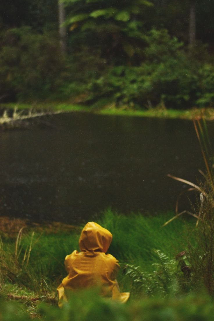 yellow raincoat, in the first by a lake  photography