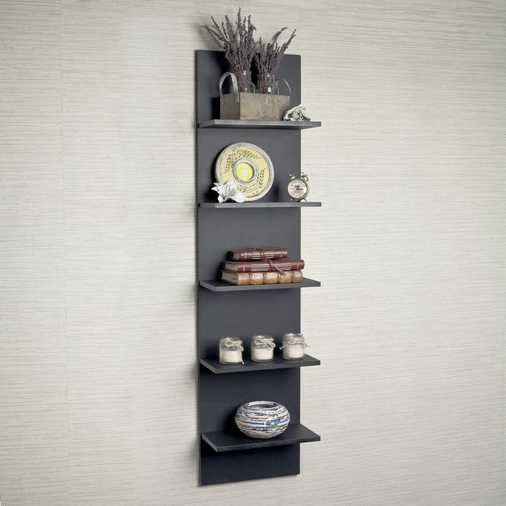 This black finish column wall shelf is a creative modern design and space saving solution for small areas.