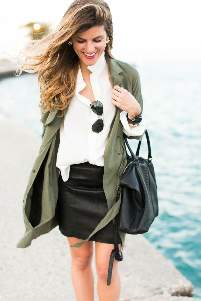 outfit featuring black leather mini skirt and white blouse and green draped jacket