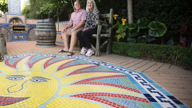 Debra, with Guy's help, began her mosaic project in the terrace.