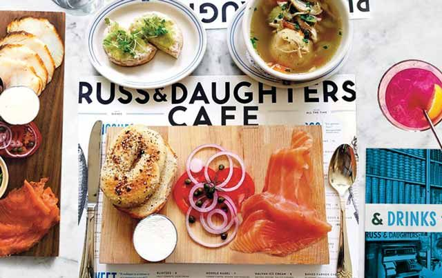 Russ & Daughters Café ~ Head to this all-day cafe from the team behind century-old appetizing shop Russ & Daughters for smoked fish platters, caviar, blintzes, borscht, scrambled eggs with lox, and latkes with salmon roe. Russ & Daughters Cafe has a full bar serving cocktails with Eastern-European flourishes, as well as shrubs and house-made sodas. Some diners come here just for the sweets, like the halvah ice cream sundae and challah bread pudding.