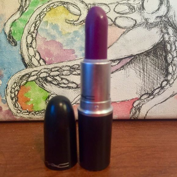 Heroine Mac Matte Lipstick Matte purple lipstick. I've used it twice and sanitized it. It's basically new! :) MAC Cosmetics Makeup Lipstick