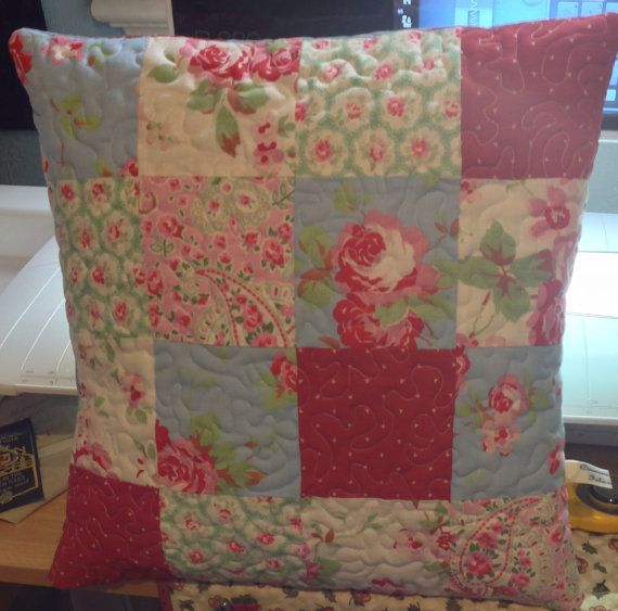 Quilted patchwork cushion or pillow featuring Cath Kidston fabrics.  Envelope closure with embroidery detail
