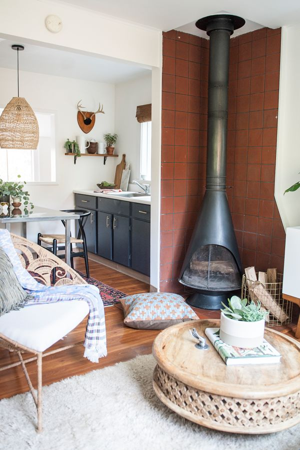 Vintage 70's Wood burning stove in Mid-Century Modern living room with a boho twist. Home Tour - Ashley Redmond - The Tiny Treehouse - Interior Designer — via HouseOfHipsters.com