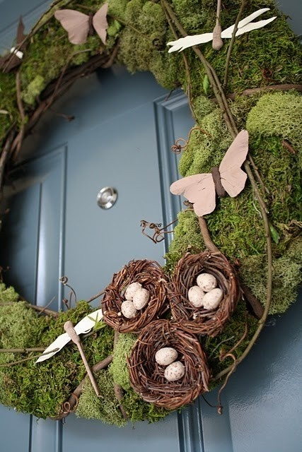 this moss covered wreath celebrates the season so well with dragonflies and butterflies flitting about.
