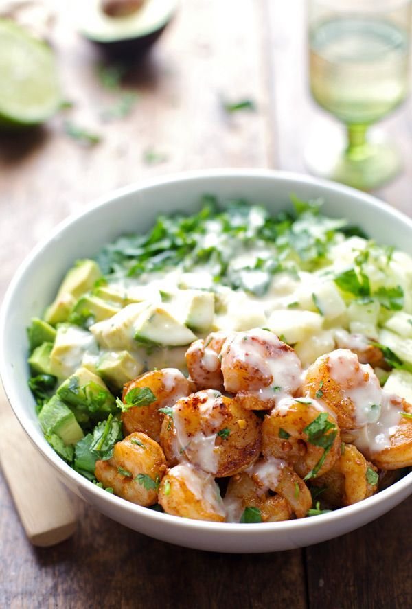 This spicy shrimp and avocado salad has cucumbers, spinach, shrimp, and avocado with a creamy miso dressing. Awesome healthy lunch! | pinchofyum.com
