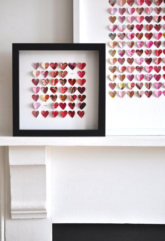 Framed Hearts (or other shapes)   British artist Veronika Pollard cuts out tiny hearts from colored paper or newspaper and then arranges them in artful ways.  She'll also incorporate initials or a wedding date.  Sweet!