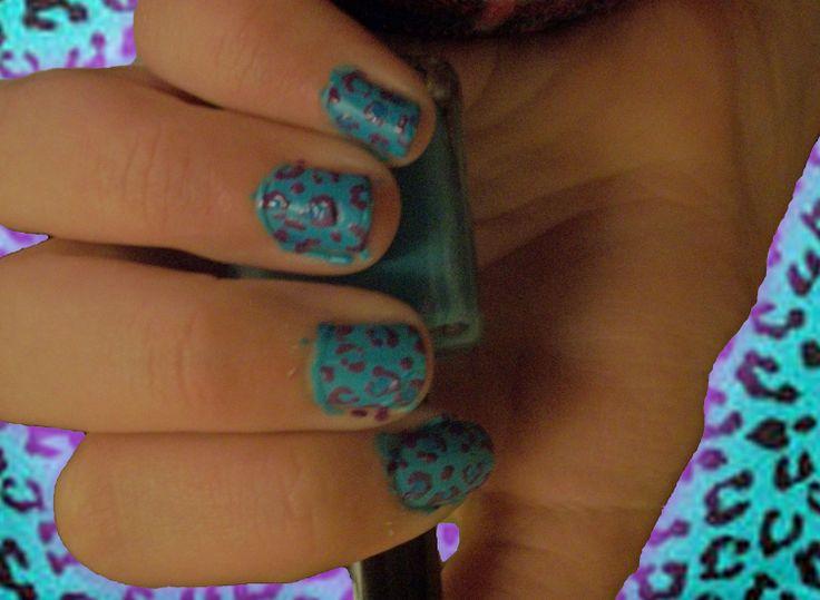 Blue and purple cheetah print nails