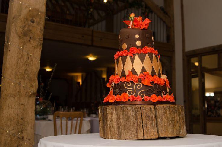 Fantastic gold and orange wonky chocolate wedding cake !