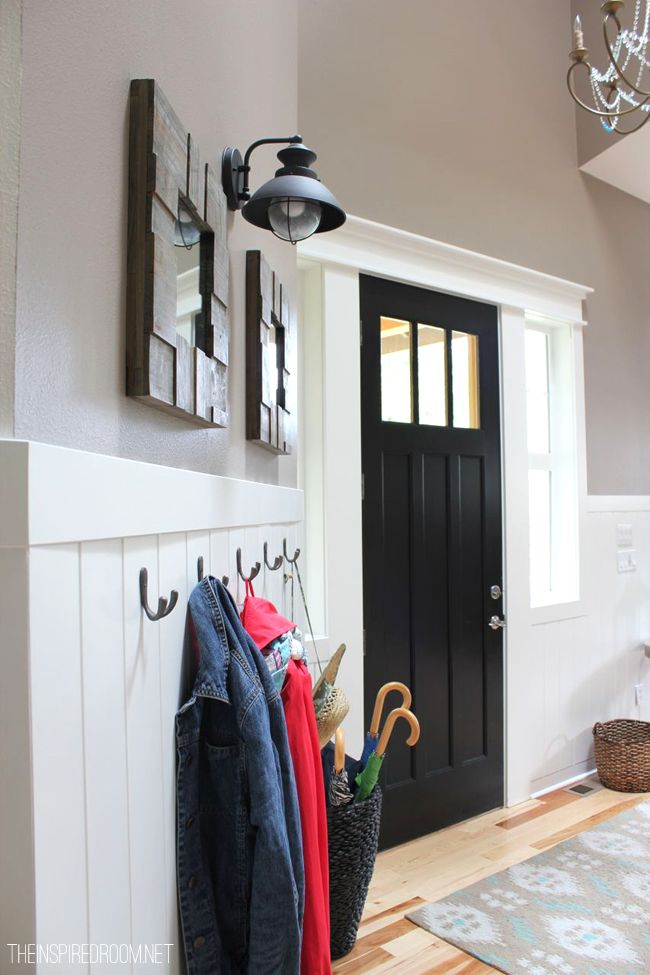 entry makeover- I like this door! Black with the three windows over top and nice crisp white trim.