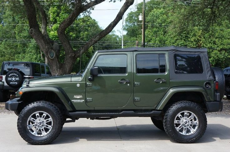 First Year of the 4 Door 2007 Jeep Green Unlimited Wrangler Sahara.... http://www.selectjeeps.com/inventory/view/9295541/2007-Jeep-Wrangler-4WD-4dr-Unlimited-Sahara-League-City-TX