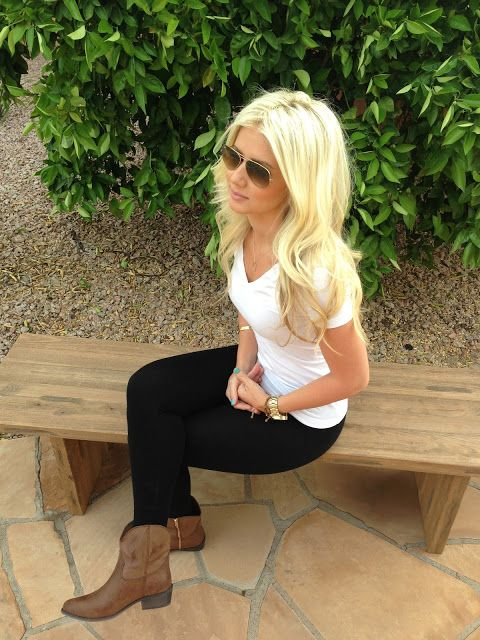 Simple white tee , black jeans and brown booties.