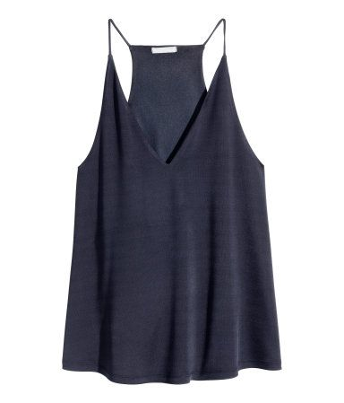 Flared, V-neck camisole top in jersey with a sheen. Narrow shoulder straps and racer back. Lined at top.