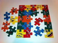 Googly-Eyed Monster Puzzle. See tutorial at:  http://www.cutoutandkeep.net/projects/googly-eyed-monster-puzzle