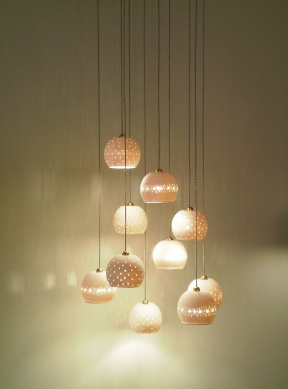 ceramic lights by lightfixture tamar. Love how delicate these are.