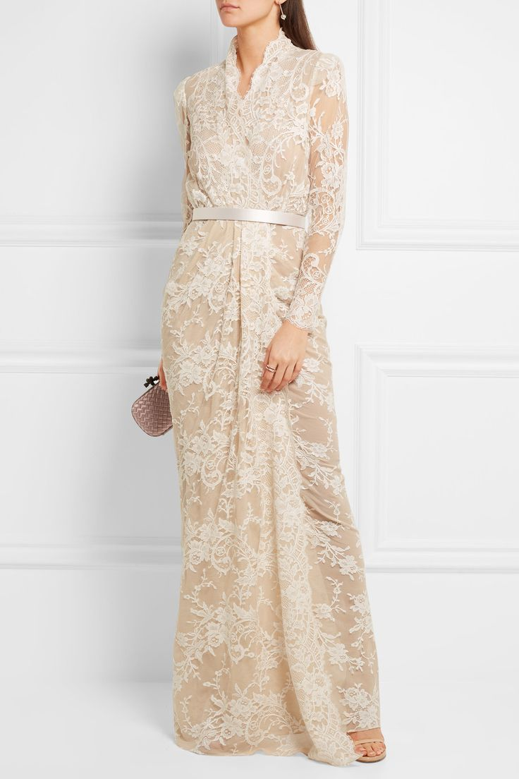 Lovingly crafted in Italy, Alexander McQueen's ornate cotton-blend lace gown is detailed with pretty scalloped edges and delicate eyelash fringing. This silk-lined design has sheer sleeves, a waist-defining detachable belt and front slit for ease of movement. We love the timeless elegance of its wrap-style column silhouette.   Shown here with: Bottega Veneta Clutch, Stuart Weitzman Sandals, Sophie Buhai Earrings, Bottega Veneta Rings.
