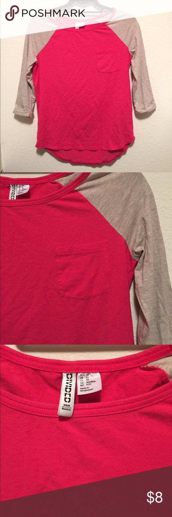 3/4 Baseball T-Shirt This 3/4 baseball t-shirt is perfect year round! The eye popping pink of the shirt's body is complemented very nicely by the neutral tan arms! No signs of wear. *Ships next day* Divided Tops