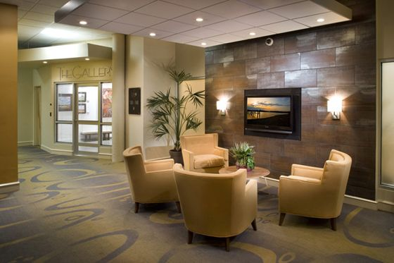 Business Foyer Design : A cosy living room look for the waiting area next to