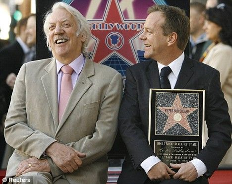 Kiefer Sutherland (R) smiles with his father actor Donald Sutherland after being honored with a star on the Walk of Fame in Hollywood