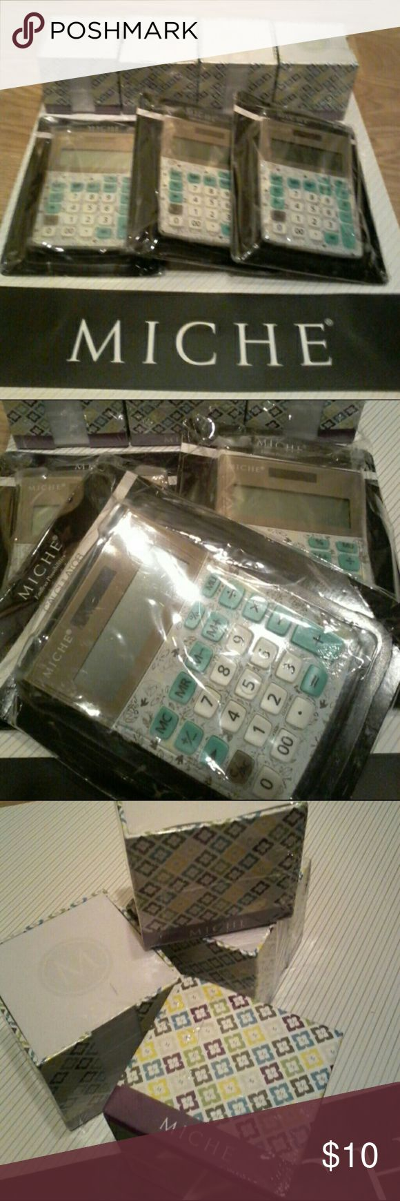 "NEW Miche Calculator & Note Cube HTF You are purchasing 1 set: 1 calculator & 1 note cube.  Several available.  Calculator measures 4.5"" wide x 6"" tall & features dove hope pattern   Great Gift idea! All items are new in original packaging.  SMOKE FREE HOME   Thanks for looking :) Miche Accessories"
