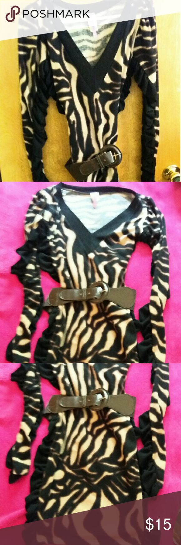 SOLD. Tiger striped dress Light weight sweater ruched sides long sleeves deep v neck . Body hugging Dresses Mini