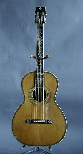 """Dan Fogelberg Instruments - WASHBURN ACOUSTIC. """"The oldest guitar in the collection. 1890 something. Incredible inlay.  A beautiful instrument that for it's size sounds remarkably large and gorgeous. Records beautifully."""""""