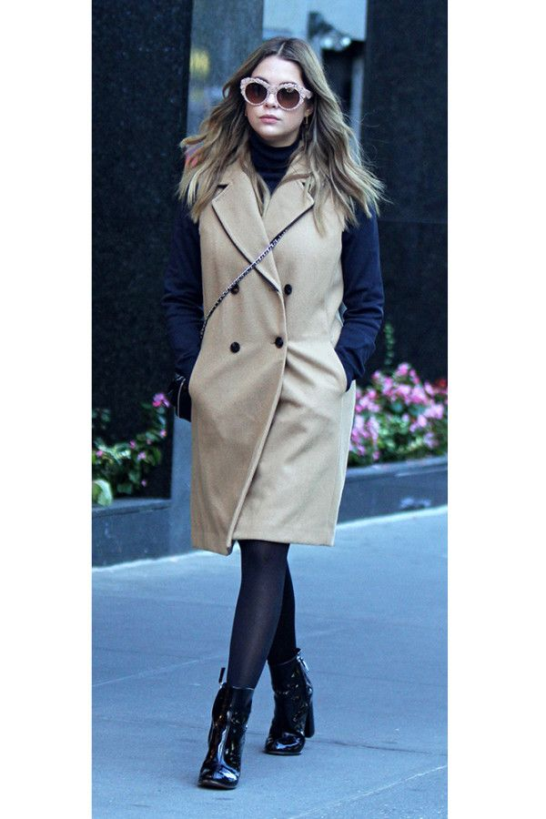 Ashley Benson - Exhibit masterful layering by topping a turtleneck sweater with a sleek waistcoat. A cross-body bag, retro sunnies and patent booties complete the street-wise ensemble.