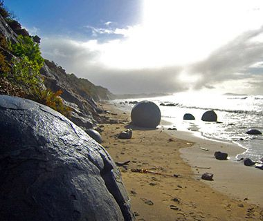 Moeraki Boulders, New Zealand - The spherical stones that line New Zealand's Moeraki Beach reach up to seven feet in diameter. They're actually concretions, masses of compacted sediment formed below ground more than 50 million years ago. As the sand that surrounds them erodes, they seem to rise to the surface as if pushed up from the center of the earth.