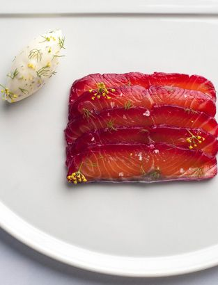 This salmon recipe makes a fantastic starter or canapé.The fish is marinated in soy and beetroot, and the sharp fennel pollen cream serves to counter the earthiness of the salmon and is simple enough to prepare.