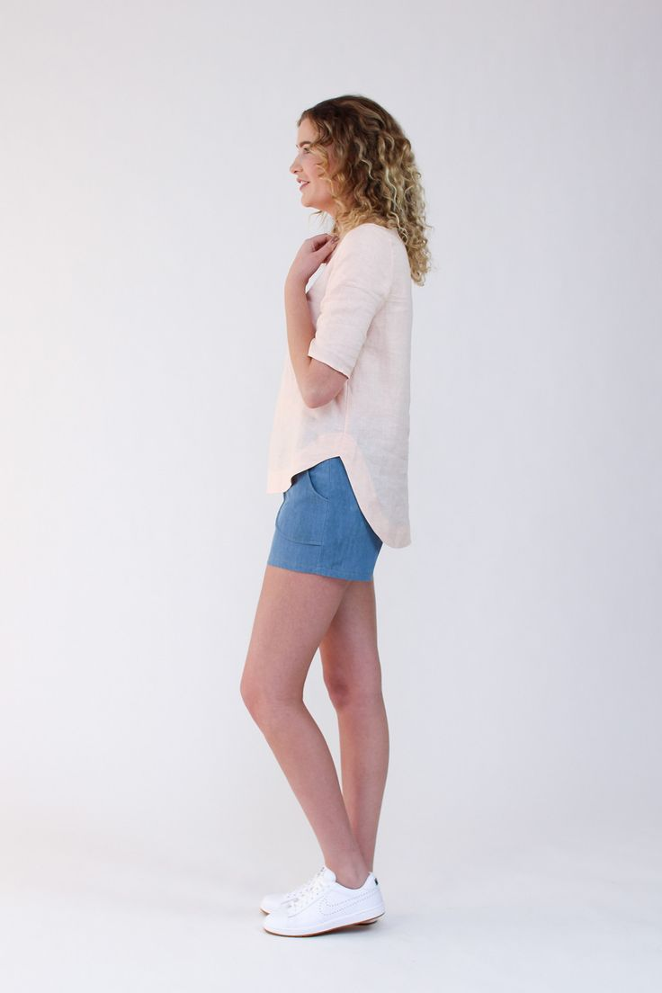 Dove blouse sewing pattern V1 side view, shows detail of the curved hemline with facing