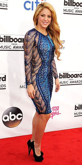 Chart-Topping Style: The Billboard Music Awards Looks | SHAKIRA  | Never one to shy away from a dress that shows off her killer curves, the star puts her bod on display once again in a second-skin blue midi with sheer netted panels.