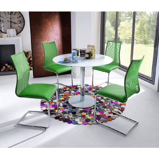 falko round glass dining table with 4 kim dining chairs in green