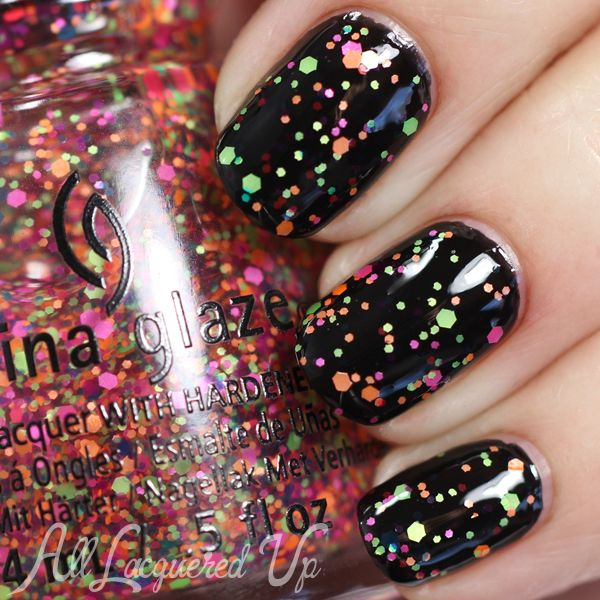 China Glaze Electric Nights nail polish over black (Summer 2015) - Point Me to the Party is a clear-based glitter topper with neon green, pink, blue and orange hex glitter of varying sizes.  #mustbuy