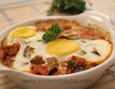 How to make Baked Aubergine and Eggs Recipe - Spiced aubergine mixture topped with eggs and baked.-  Sanjeev Kapoor exclusive recipe