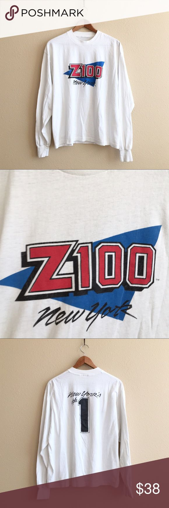 Z100 NY Radio Tee Perfectly worn in long sleeve tee with Z100 on front and New York's #1 on back. There are a few small discolorations that were hard to capture. Throw this on under a puffer vest!  BRAND: - MATERIAL: 50/50 YEAR/ERA: late 80s LABEL SIZE: - BEST FIT: S/M  MEASUREMENTS: Chest 22 inches  Length 25.5 inches    I do not model or trade, sorry!  Check out my closet for more vintage! Vintage Tops Tees - Long Sleeve
