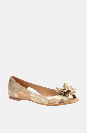Gold shoe with flower embelishment