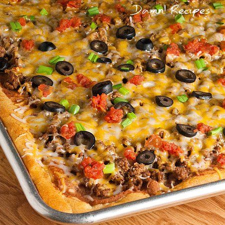 TACO PIZZA 1 lb. ground beef 1 envelope taco seasoning mix 2 (8 oz.) cans Pillsbury crescent rolls 1 (16 oz.) can refried beans (I used the jalapeño kind) 2-3 cups shredded cheddar cheese or Mexican blend 1/2 cup chopped tomatoes 1/4 cup sliced black olives 4 green onions, chopped I would sub kidney beans for the meat to make a vegetarian dish
