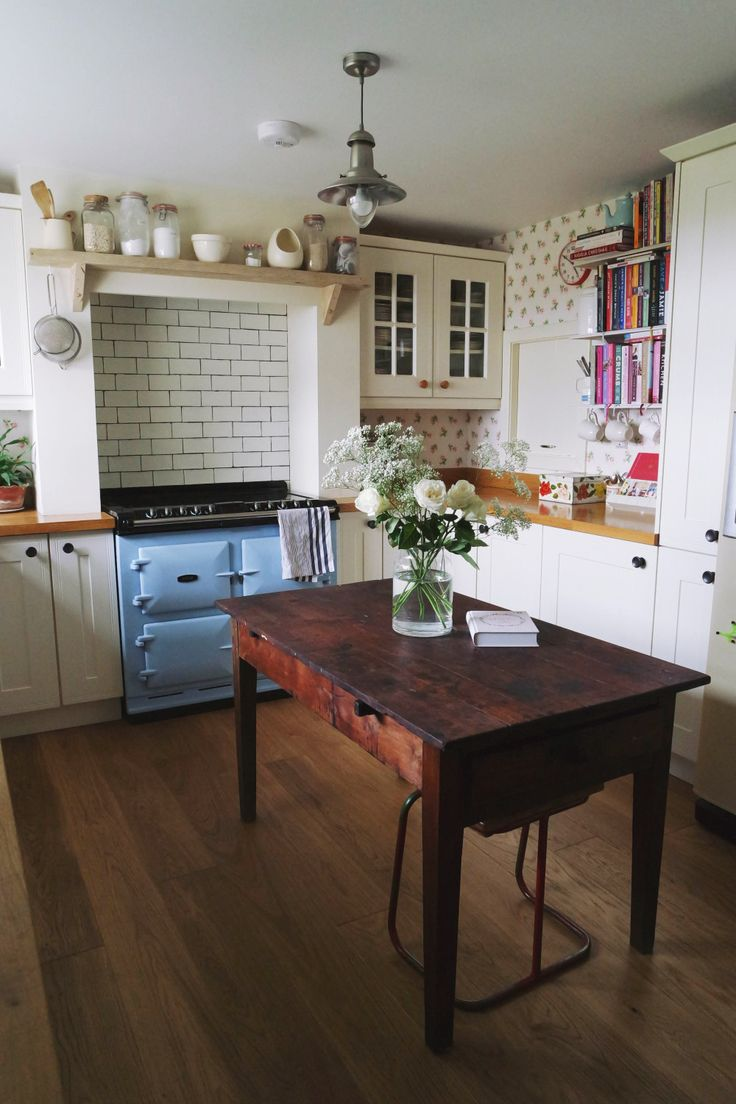 Old family table; lovely blue stove. Rise and Shine to Your Scottish Pastoral Fantasy   Design*Sponge