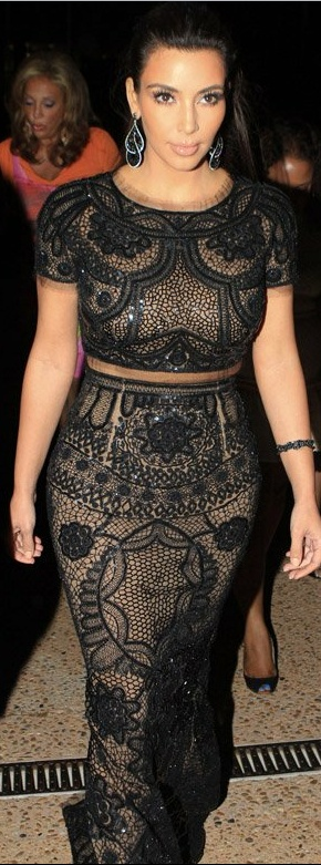 Who made Kim Kardashian's short sleeve top and nude with black bead long skirt that she wore in Cannes on May 22, 2012?