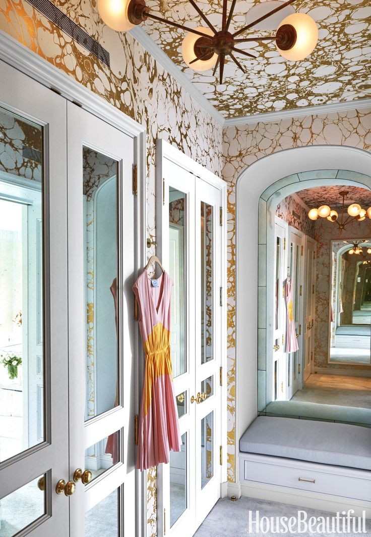 Closet | Celerie Kemble | Calico wallpaper ceiling mirrored doors